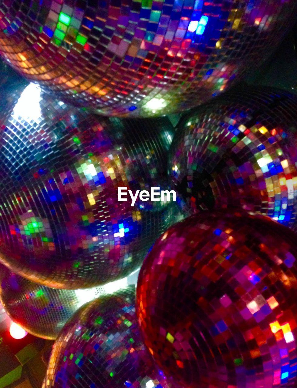 Close-up view of disco balls