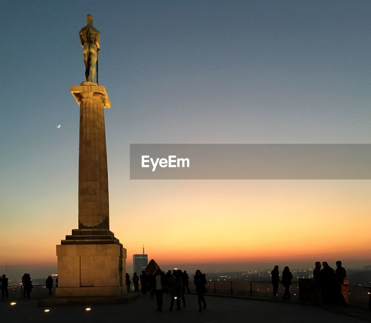 sky, sunset, sculpture, statue, travel, nature, human representation, art and craft, architecture, tourism, representation, large group of people, memorial, travel destinations, architectural column, clear sky, group of people, the past, history, built structure, outdoors