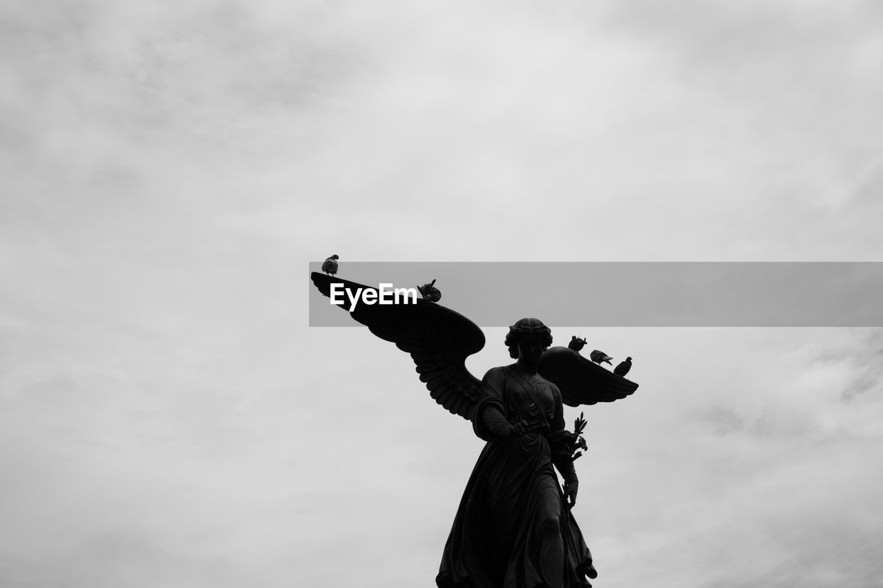 sky, cloud - sky, low angle view, nature, human representation, sculpture, representation, statue, art and craft, day, creativity, outdoors, religion, female likeness, male likeness, no people, spirituality, belief, angel, arms raised