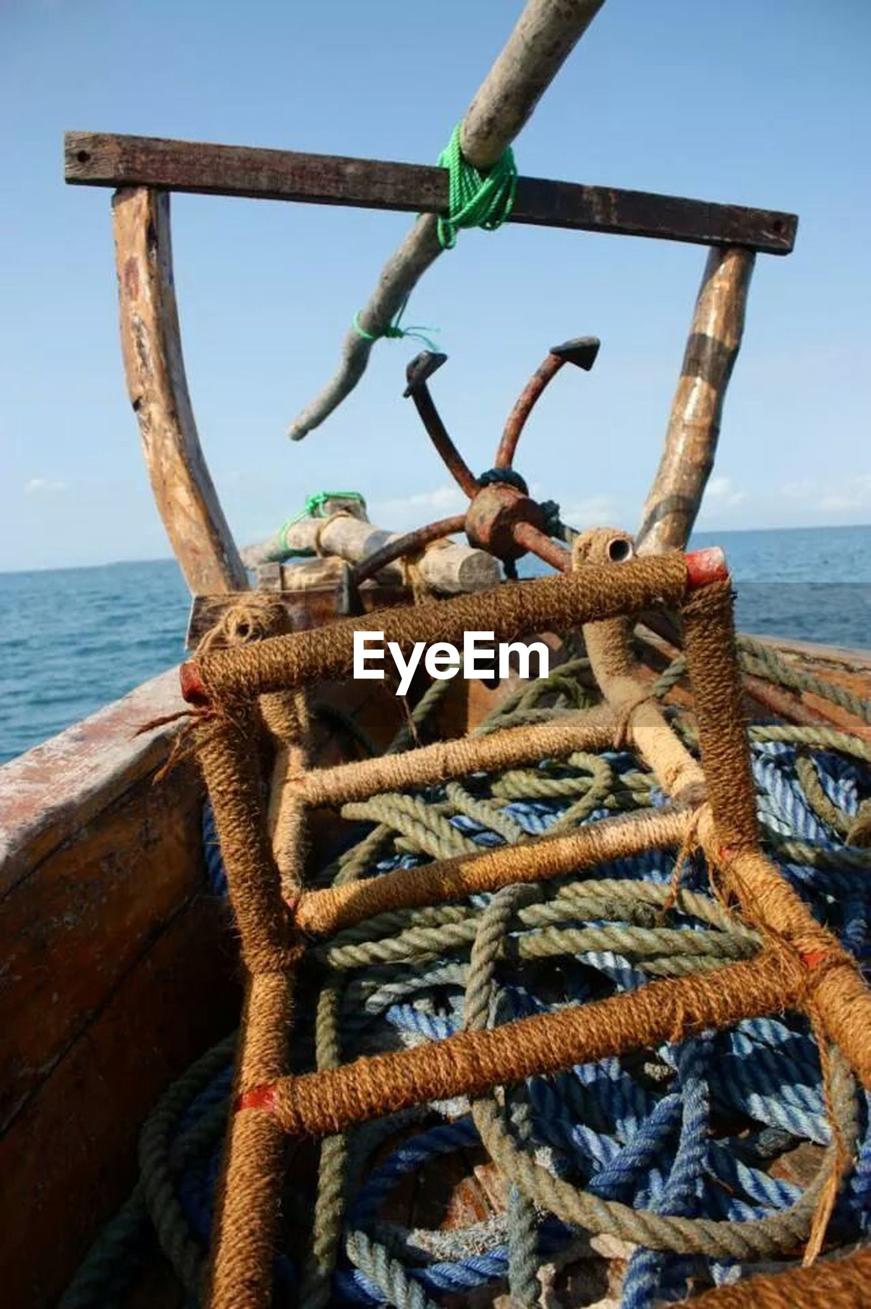 sea, wood - material, beach, water, horizon over water, rope, nature, sky, shore, tranquility, driftwood, log, focus on foreground, day, clear sky, close-up, rusty, outdoors, tranquil scene, wood