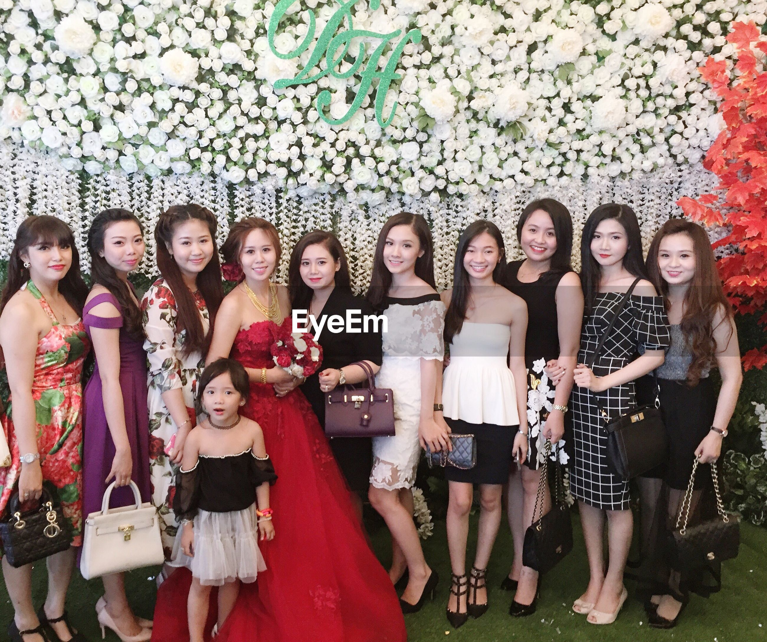 lifestyles, togetherness, leisure activity, standing, friendship, casual clothing, happiness, young women, love, bonding, large group of people, person, front view, side by side, young adult, smiling, fun, enjoyment