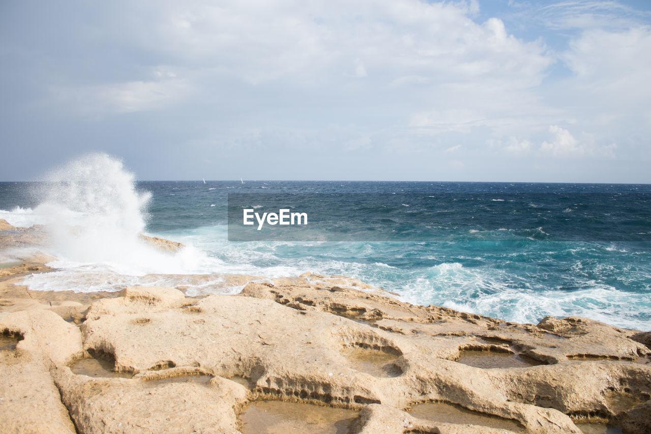 sea, water, sky, horizon over water, horizon, land, beach, scenics - nature, motion, beauty in nature, wave, cloud - sky, nature, no people, day, sport, idyllic, non-urban scene, aquatic sport, outdoors, power in nature