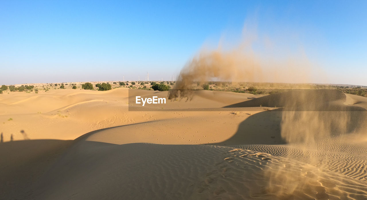landscape, sand, scenics - nature, sand dune, desert, environment, land, arid climate, sky, clear sky, non-urban scene, beauty in nature, climate, nature, day, tranquil scene, tranquility, travel, heat - temperature, travel destinations, no people, outdoors, dust, power in nature, atmospheric
