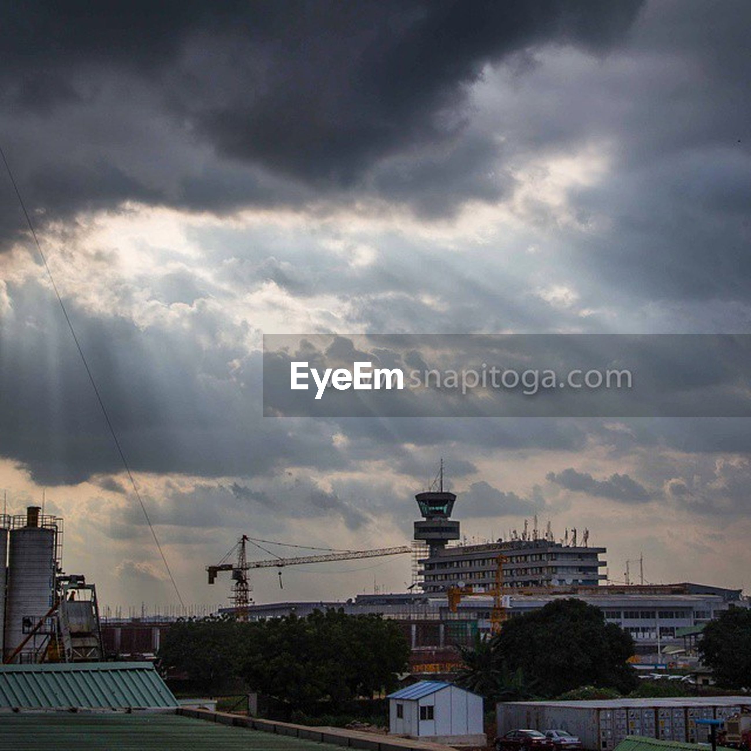 building exterior, architecture, built structure, sky, cloud - sky, cloudy, house, cloud, weather, roof, residential structure, storm cloud, residential building, city, outdoors, nature, overcast, no people, building, low angle view