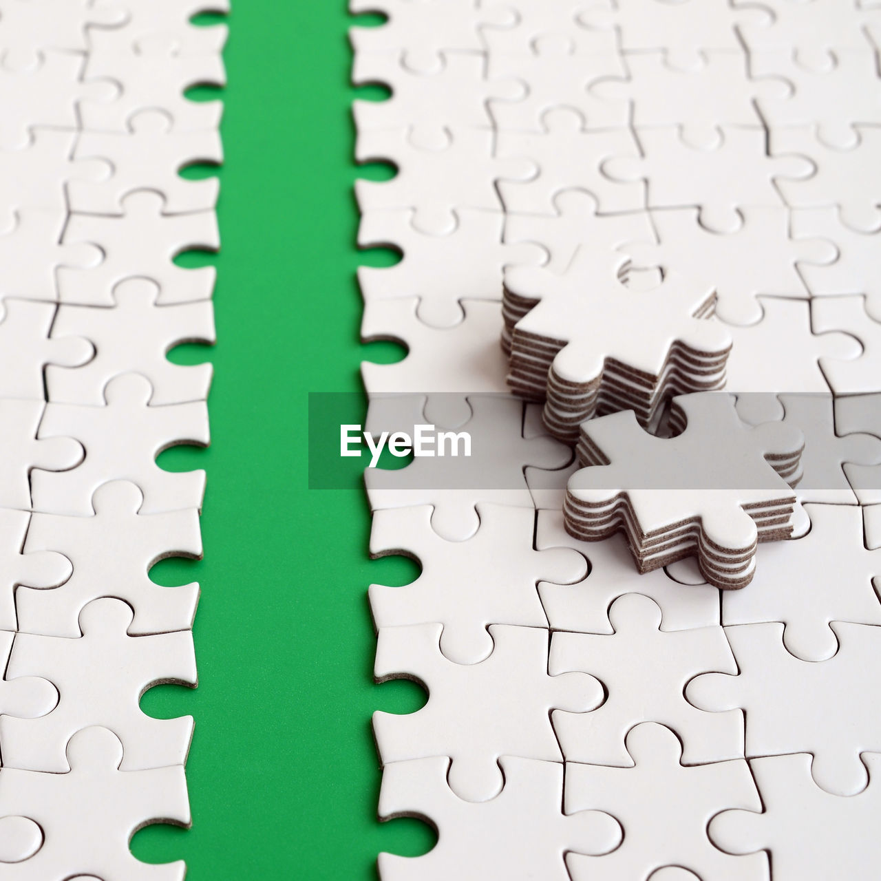 puzzle, indoors, jigsaw piece, jigsaw puzzle, pattern, full frame, connection, backgrounds, close-up, no people, white color, still life, leisure activity, green color, shape, solution, incomplete, design, strategy, high angle view