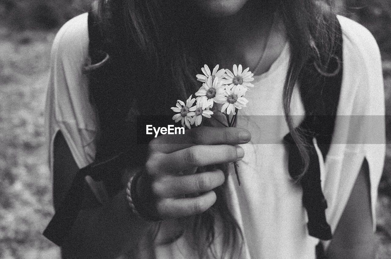 Cropped Image Of Girl Holding Flowers