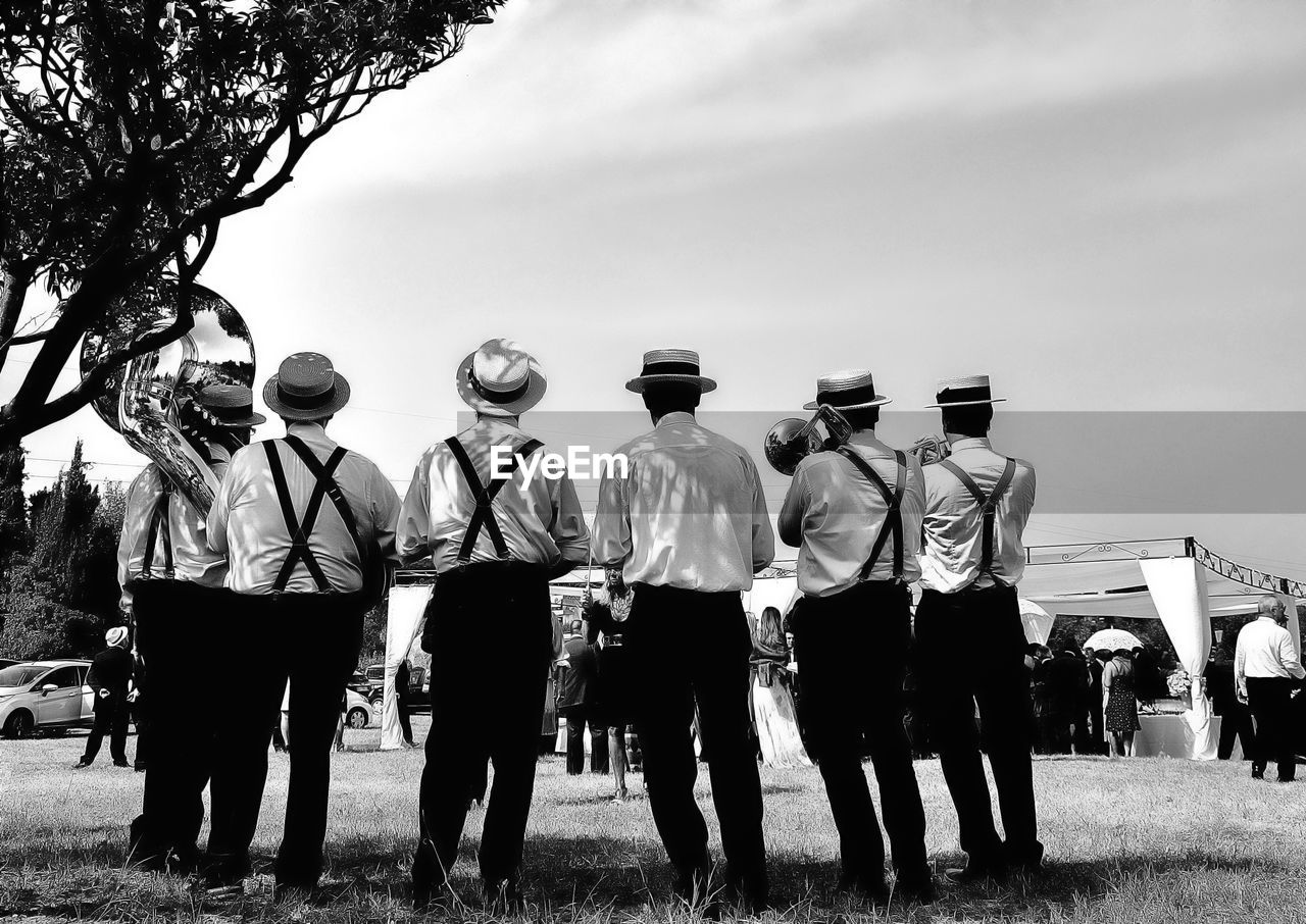 real people, men, day, sky, outdoors, large group of people, standing, full length, togetherness, lifestyles, adult, people