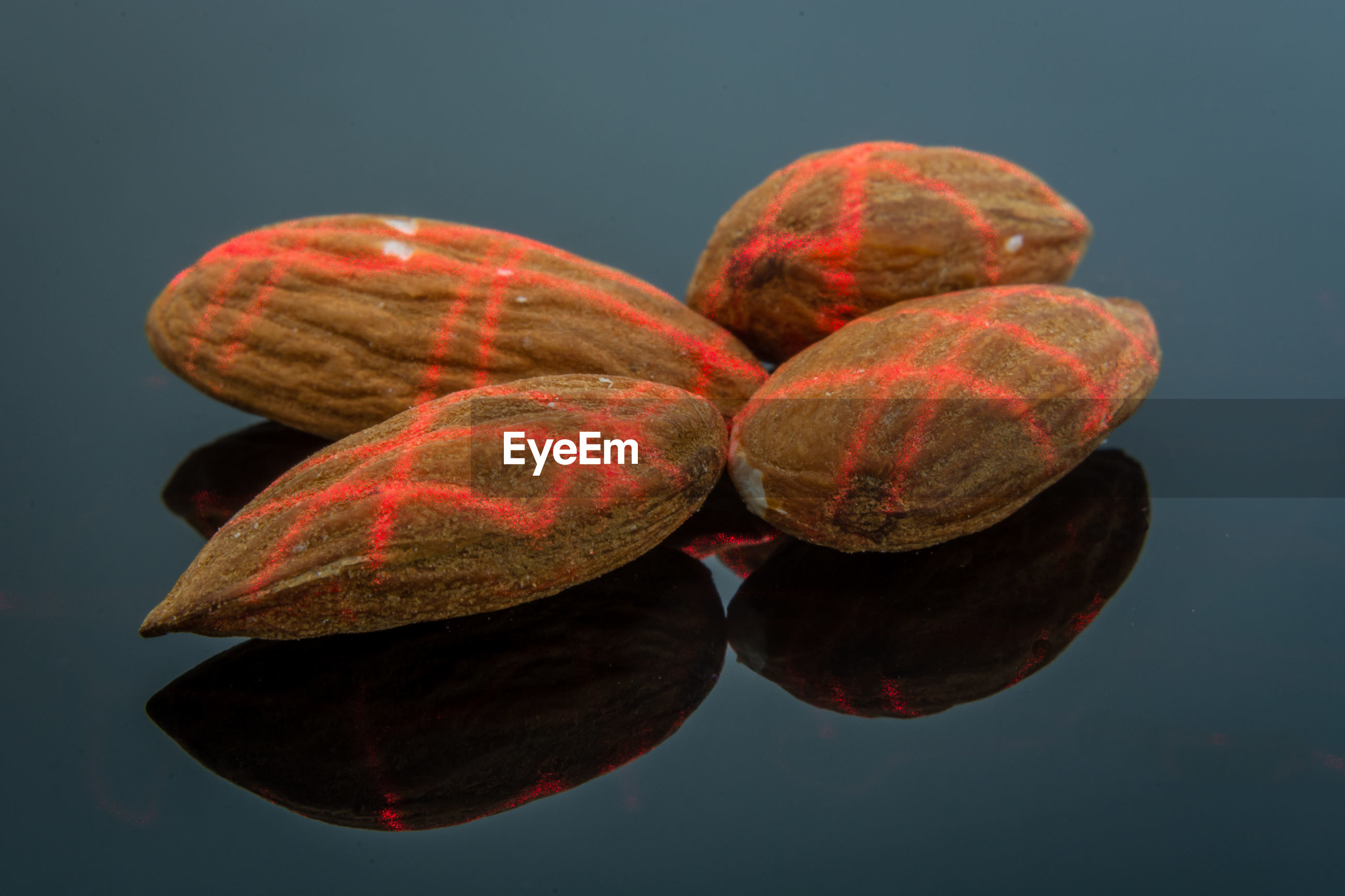 Close-up of almonds on gray background