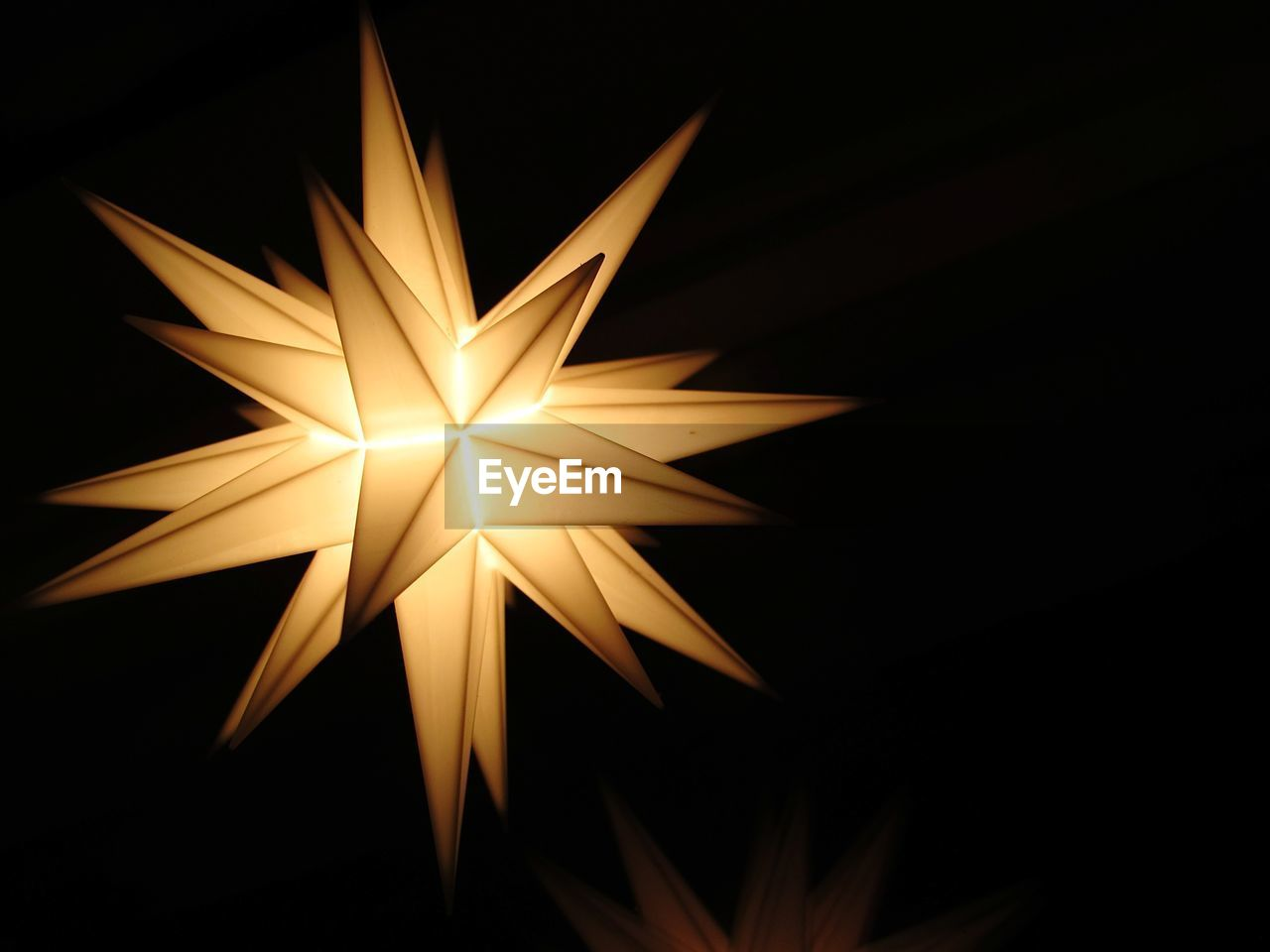 Close-Up Of Illuminated Star Shape Lantern In Dark