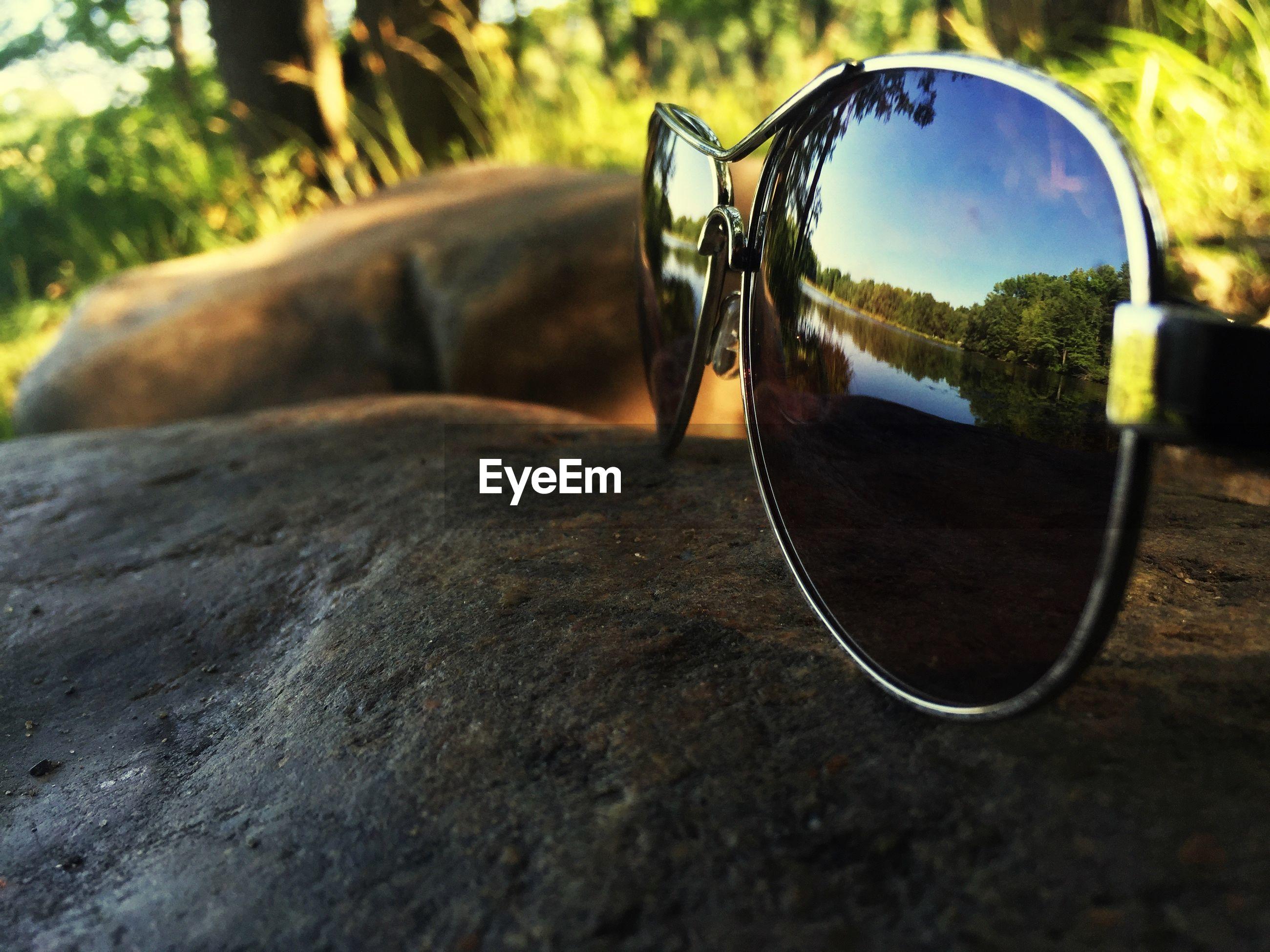 Reflection of lake on sunglasses