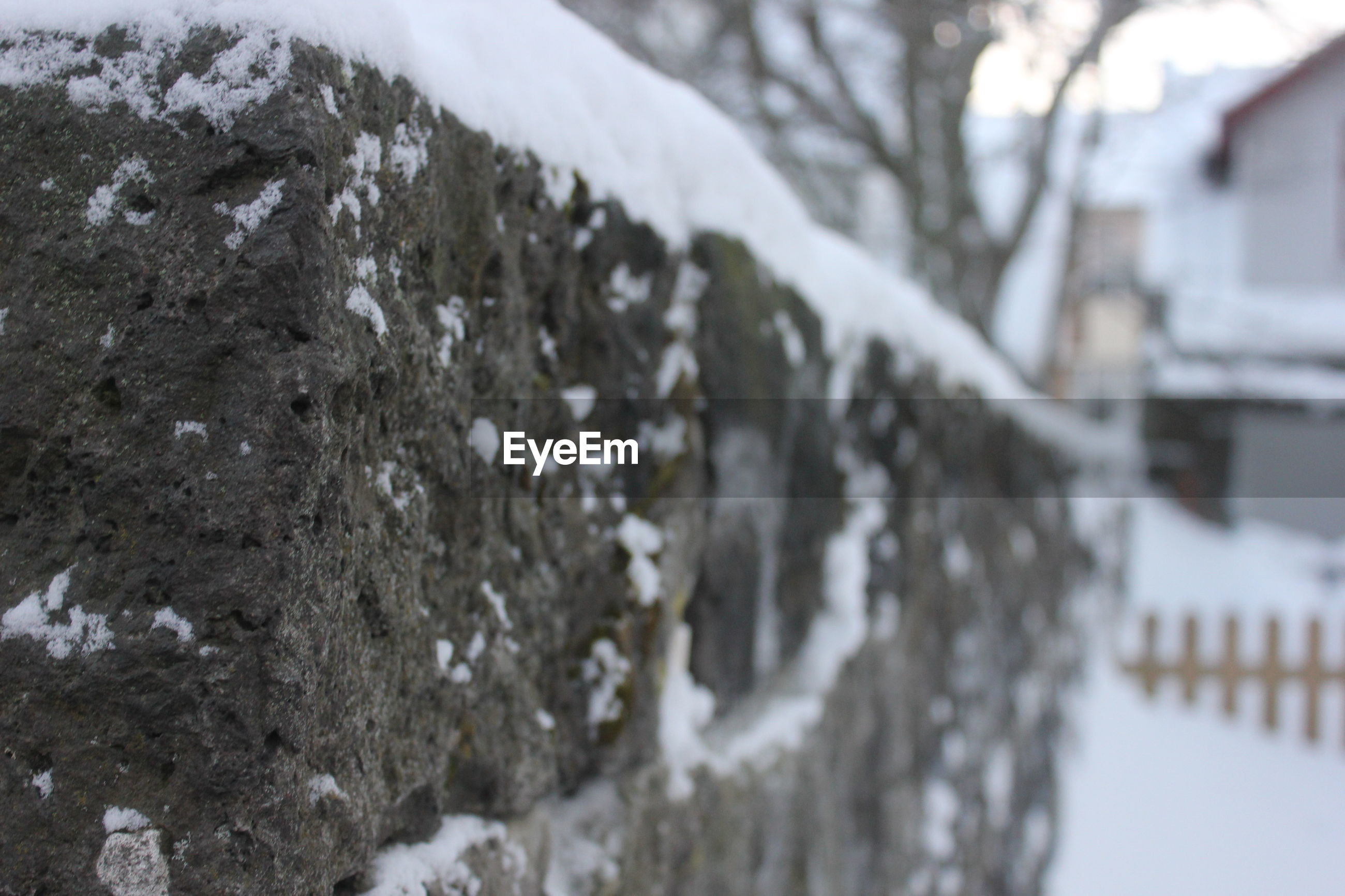 Close-up of snow covered retaining wall