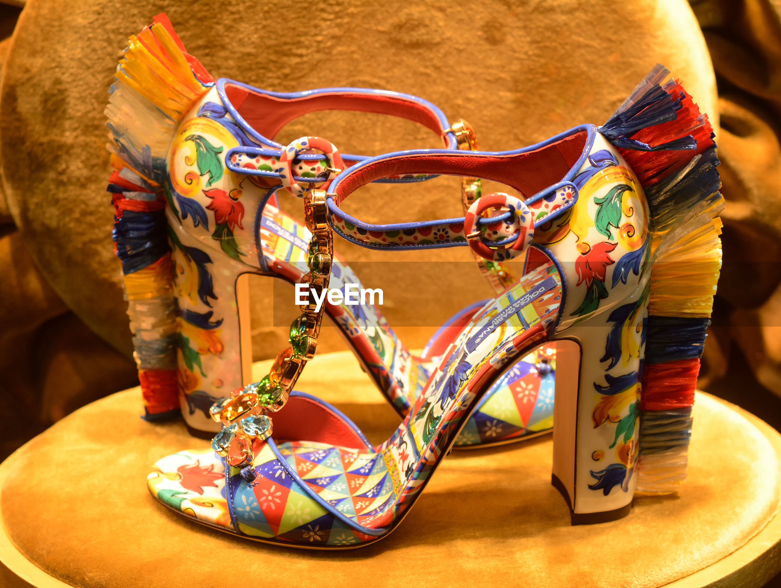 Close-up of colorful high heels on table