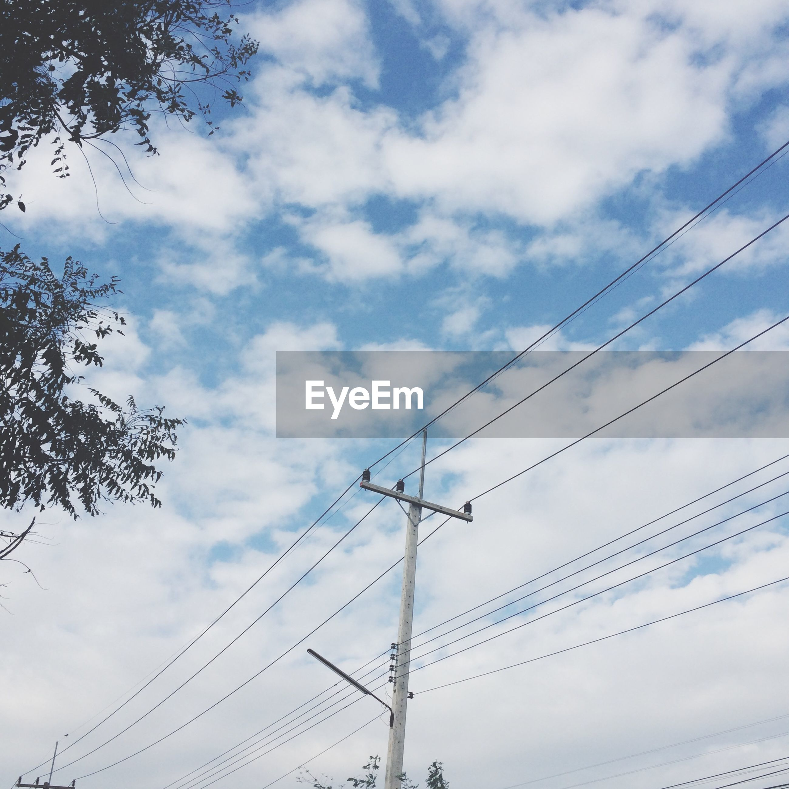 low angle view, power line, connection, sky, electricity pylon, power supply, electricity, cable, fuel and power generation, cloud - sky, cloudy, technology, cloud, complexity, day, outdoors, power cable, no people, silhouette, nature