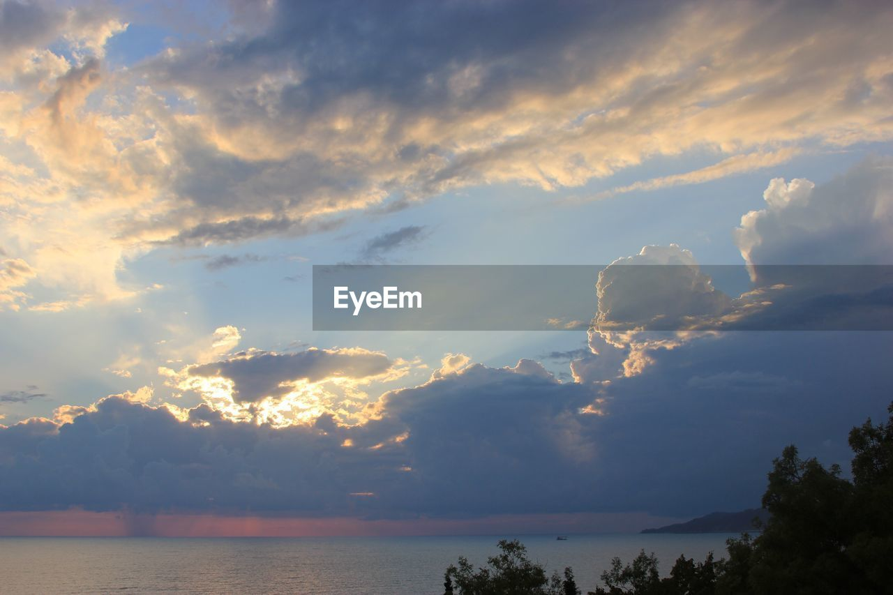 cloud - sky, sky, beauty in nature, tranquility, scenics - nature, tranquil scene, no people, sunset, sea, water, idyllic, nature, outdoors, non-urban scene, tree, horizon over water, horizon, low angle view