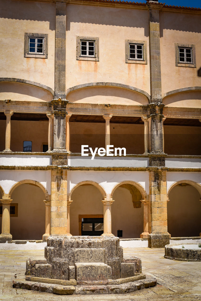 built structure, architecture, building exterior, arch, building, history, the past, window, architectural column, day, old, no people, outdoors, ancient, nature, travel, tourism, travel destinations, city, arcade, courtyard, ancient civilization, ruined, arched
