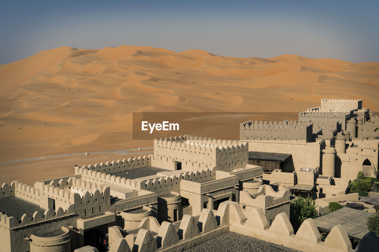 High angle view of city in desert against clear sky