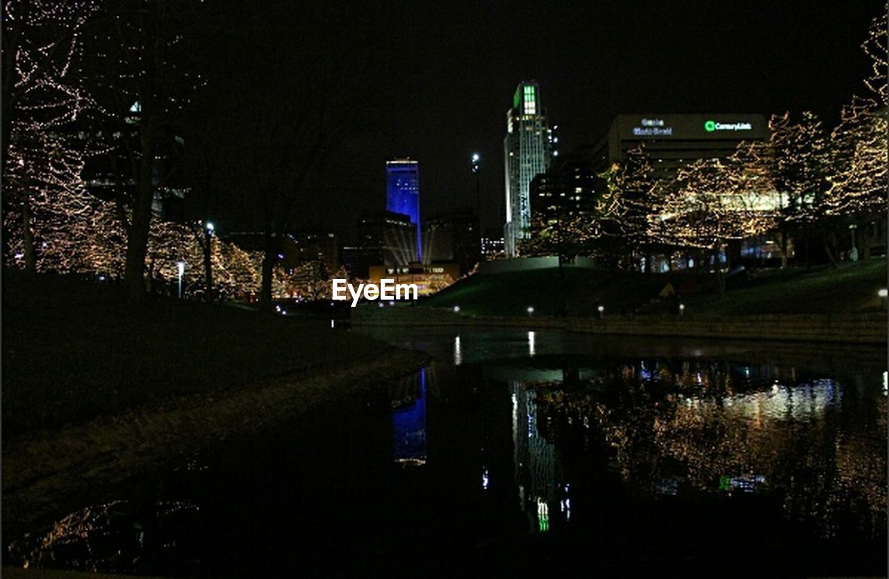 night, illuminated, architecture, building exterior, built structure, city, reflection, outdoors, modern, cityscape, skyscraper, travel destinations, no people, growth, water, tree, sky, urban skyline, nature