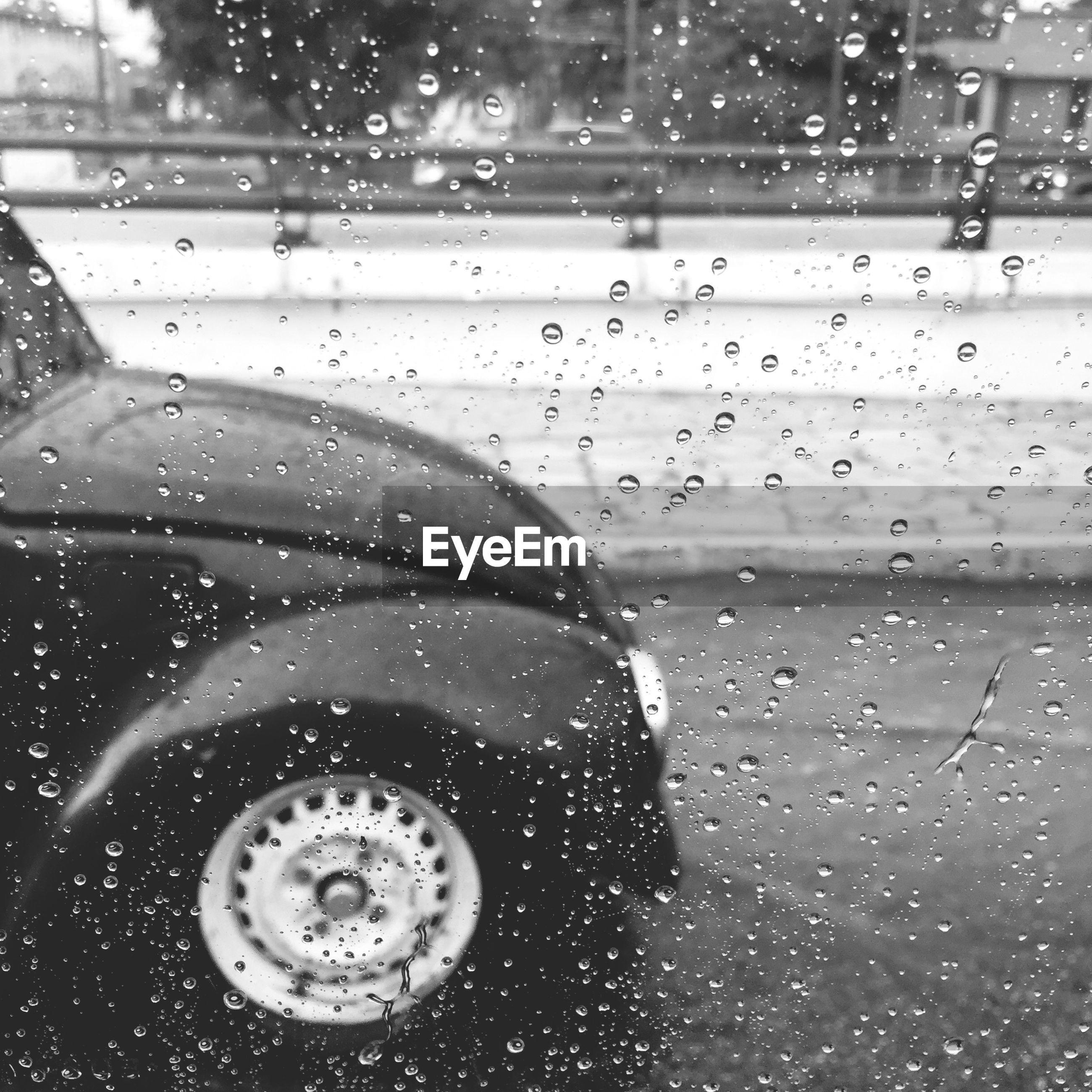 drop, wet, glass - material, transparent, indoors, rain, water, window, car, season, transportation, land vehicle, raindrop, close-up, weather, mode of transport, glass, focus on foreground, reflection, street