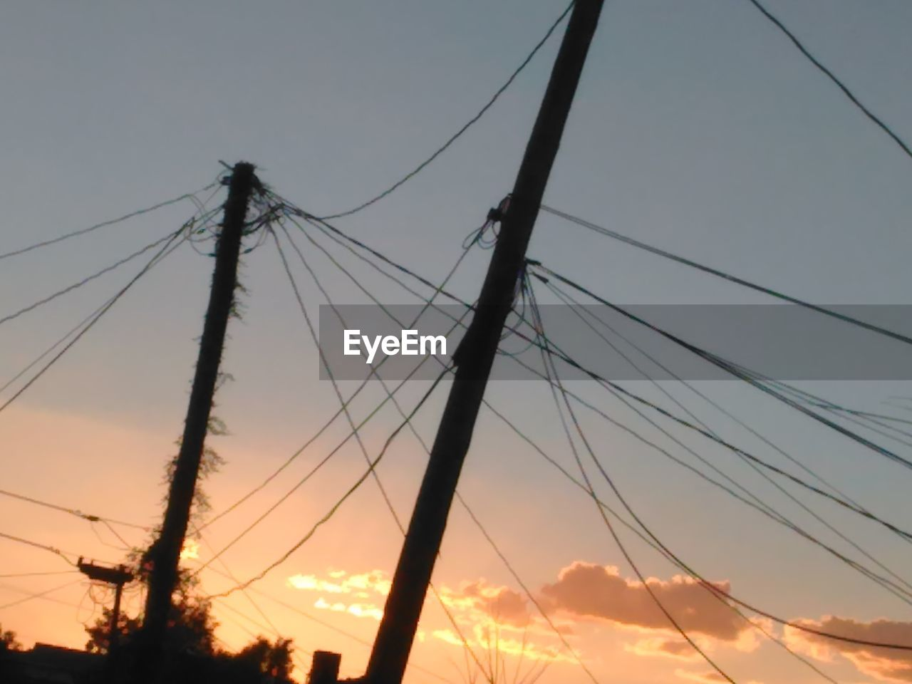 cable, connection, power line, electricity, power supply, sunset, low angle view, sky, fuel and power generation, electricity pylon, outdoors, no people, technology, complexity, telephone line, nature, day