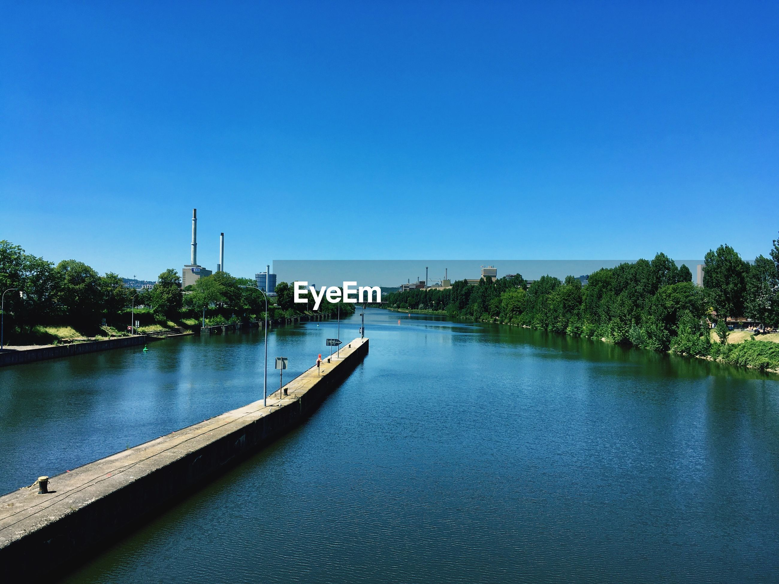VIEW OF RIVER AGAINST CLEAR BLUE SKY