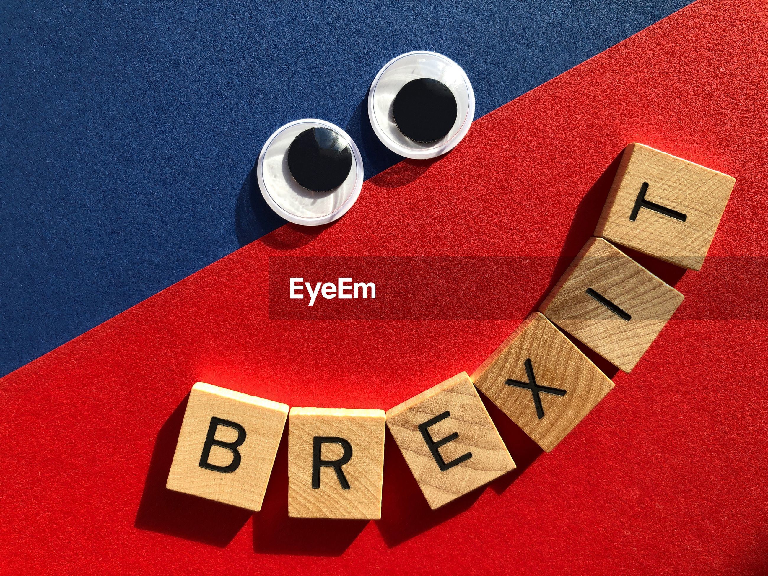 Creative concept, politics. brexit in wooden alphabet letters, happy  googly eyed  face.