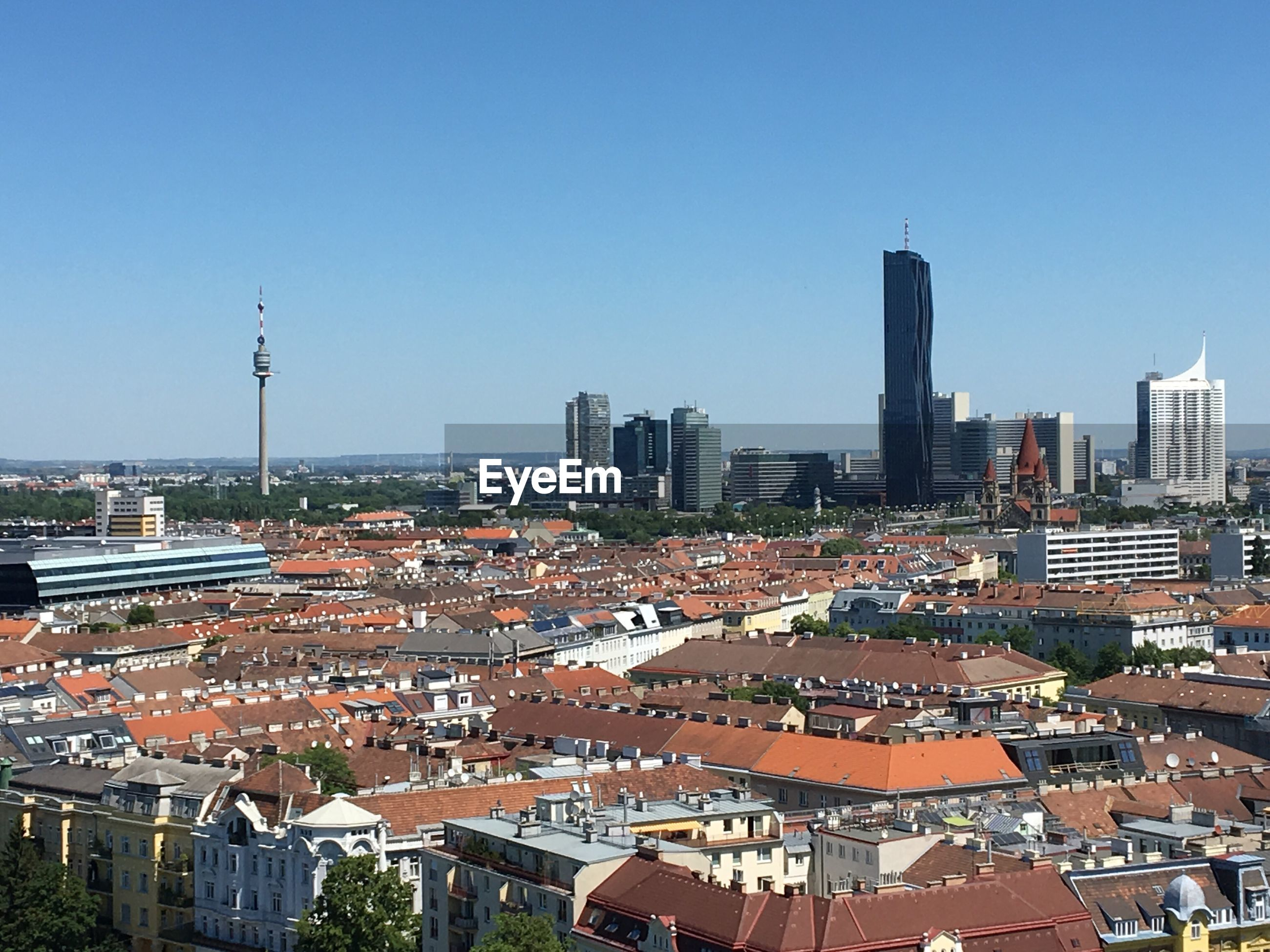 HIGH ANGLE VIEW OF CITY AGAINST CLEAR SKY