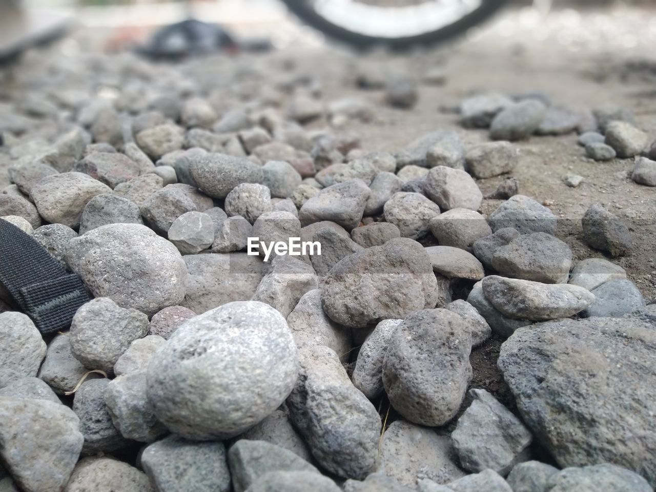 solid, rock, stone - object, rock - object, stone, no people, still life, textured, day, large group of objects, high angle view, pebble, close-up, full frame, focus on foreground, nature, abundance, backgrounds, outdoors, rough