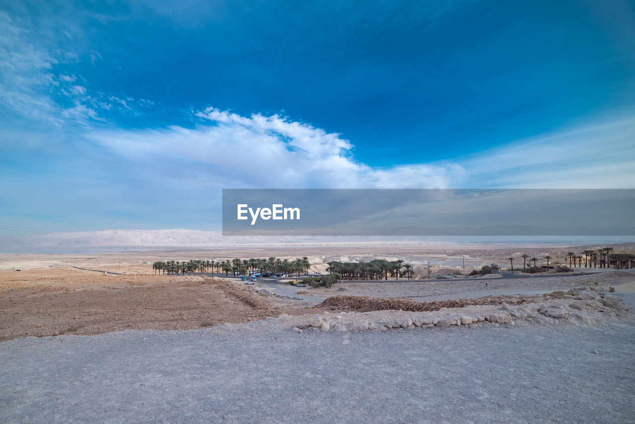 cloud - sky, sky, scenics - nature, environment, tranquility, tranquil scene, landscape, beauty in nature, blue, nature, non-urban scene, no people, day, land, desert, idyllic, outdoors, remote, road, horizon over land, arid climate, climate, salt flat
