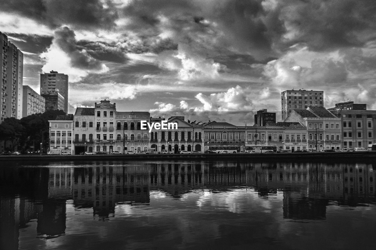 architecture, built structure, building exterior, cloud - sky, water, building, sky, city, reflection, waterfront, nature, residential district, no people, river, outdoors, day, city life, travel destinations, cityscape