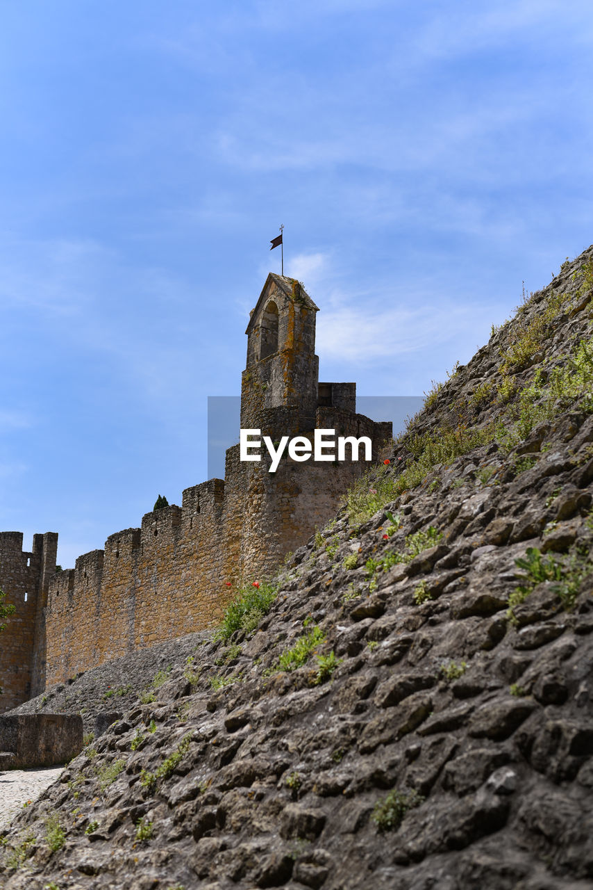 sky, low angle view, architecture, built structure, building exterior, the past, history, nature, travel, building, travel destinations, castle, fort, wall, day, old, tourism, solid, ancient, tower, no people, outdoors, stone wall