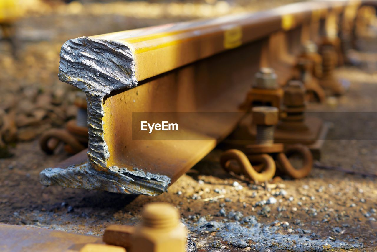 Damaged Rusty Railroad Track During Sunny Day