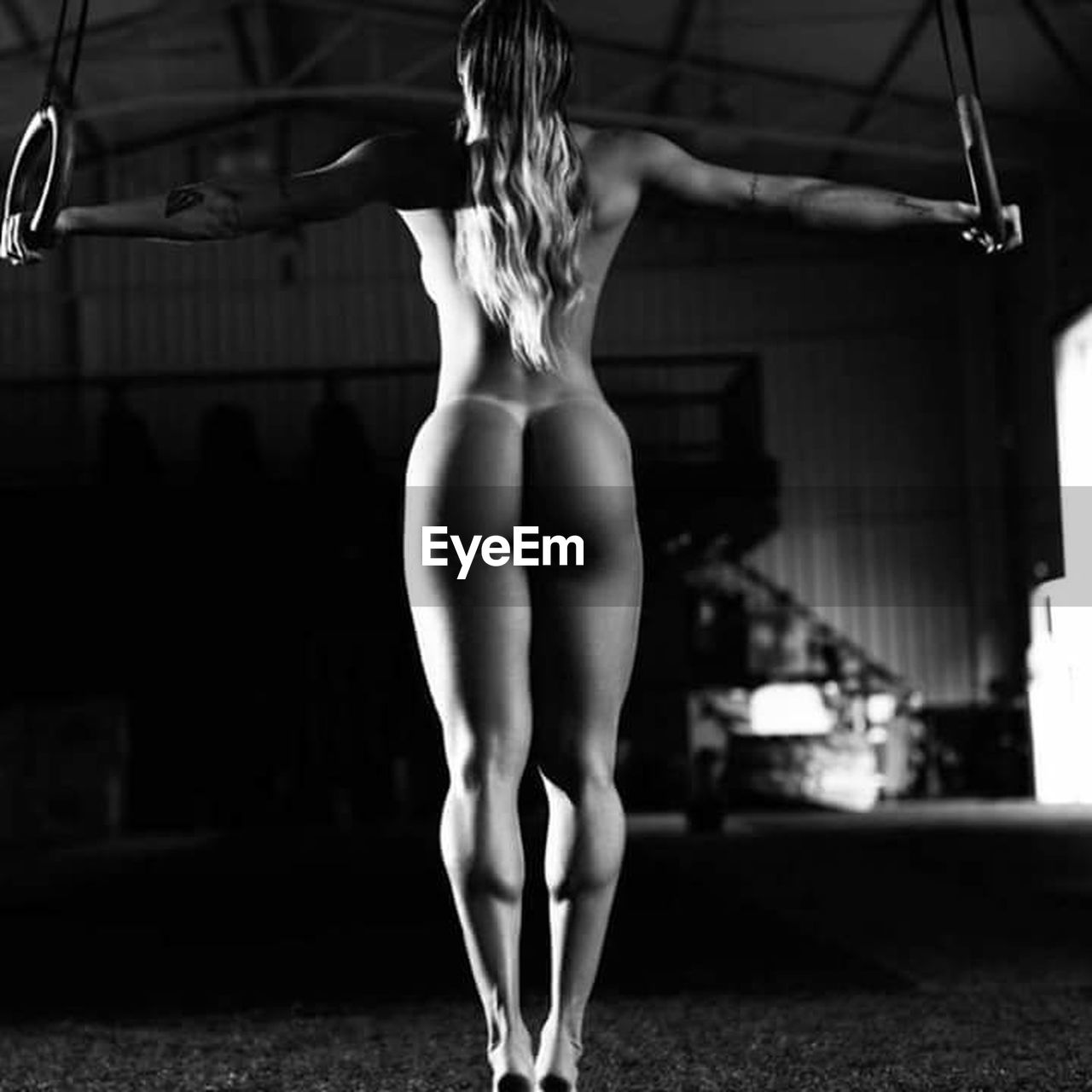 real people, rear view, one person, balance, skill, focus on foreground, flexibility, standing, ballet, indoors, lifestyles, practicing, strength, ballet dancer, young adult, legs apart, full length, women, muscular build, human back, sports clothing, back, day, athlete, adult, people, adults only