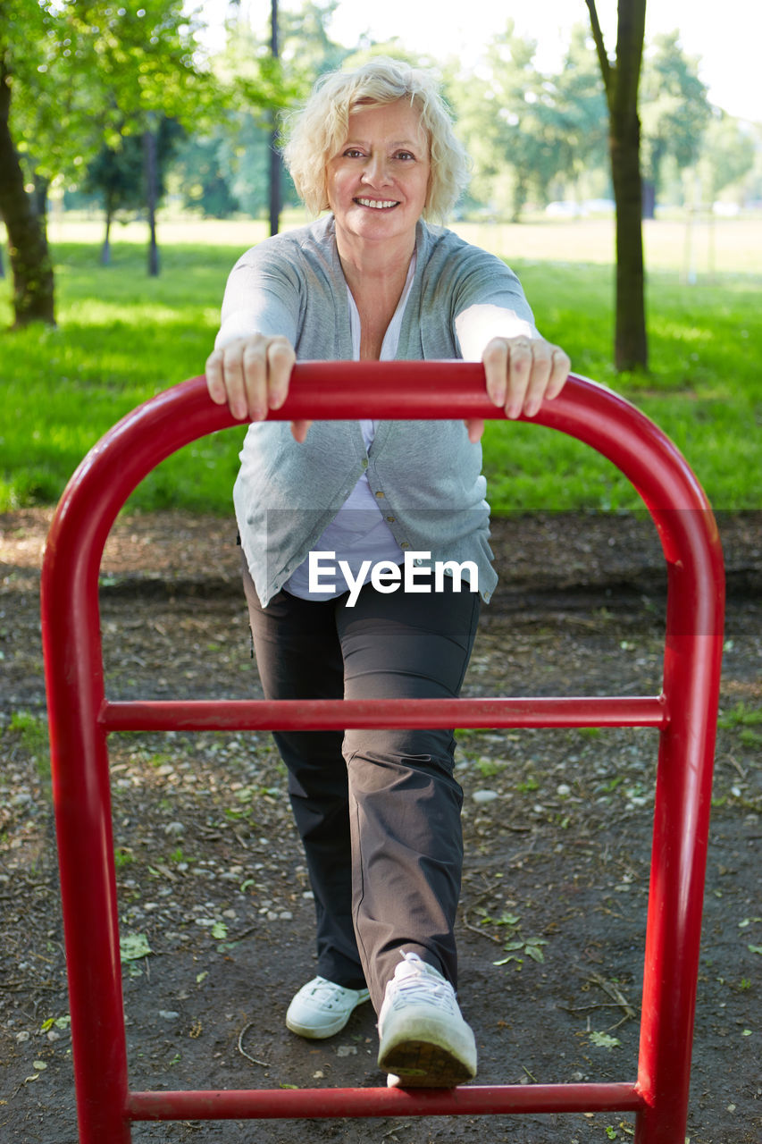 Portrait Of Woman Exercising In Park