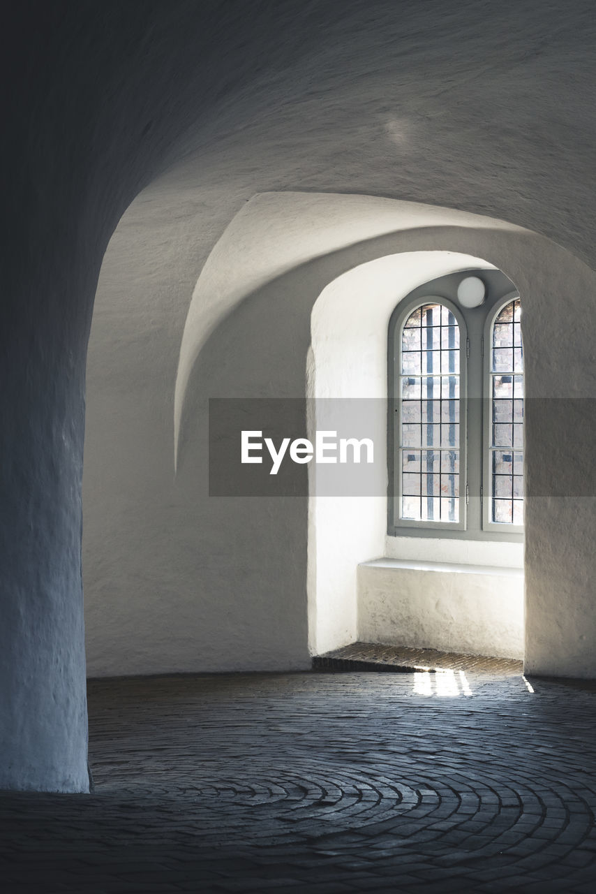 architecture, arch, built structure, indoors, building, no people, window, day, empty, the past, wall - building feature, history, the way forward, direction, nature, religion, flooring, absence, sunlight, arched, ceiling