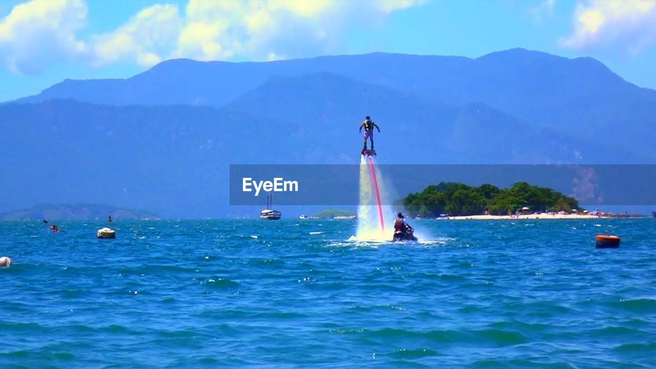 mountain, water, waterfront, sky, nautical vessel, nature, day, scenics, transportation, outdoors, sea, beauty in nature, mode of transport, cloud - sky, mountain range, blue, sailing, no people