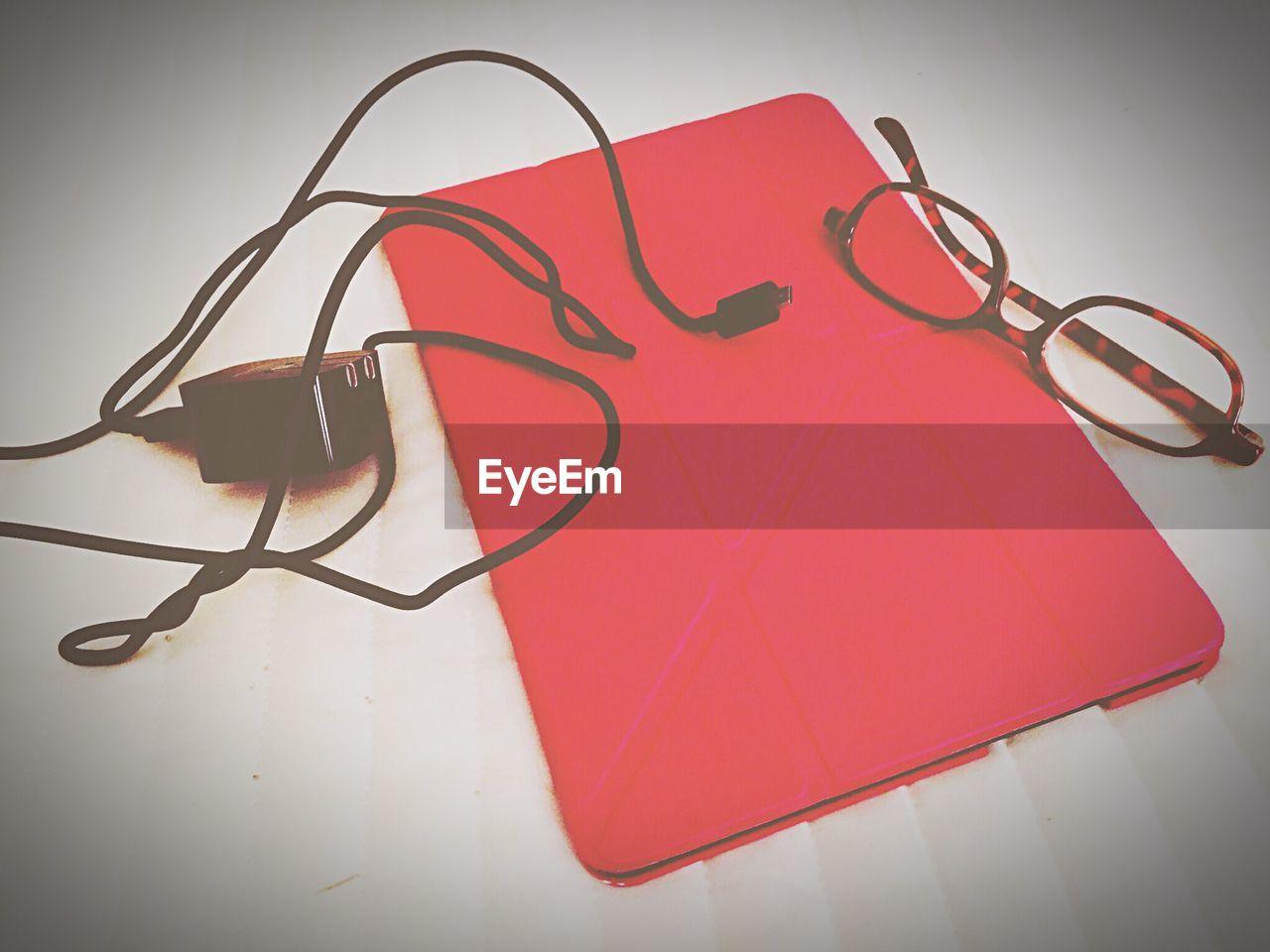 High Angle View Of Eyeglasses And Digital Tablet On Table