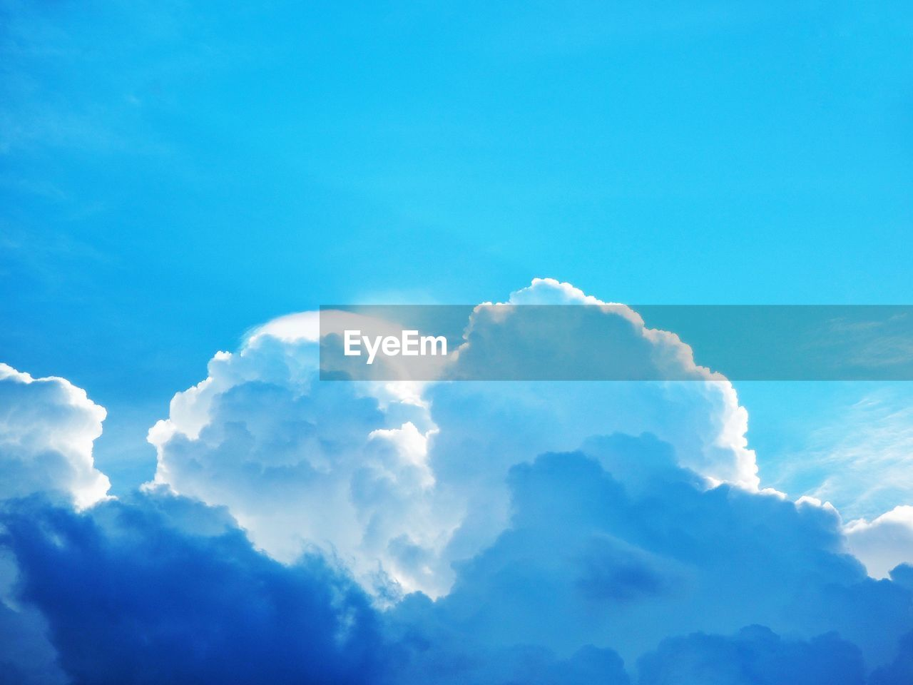cloud - sky, sky, beauty in nature, scenics - nature, low angle view, tranquility, blue, no people, nature, tranquil scene, idyllic, day, backgrounds, outdoors, cloudscape, sunlight, white color, full frame, fluffy, heaven, meteorology, softness