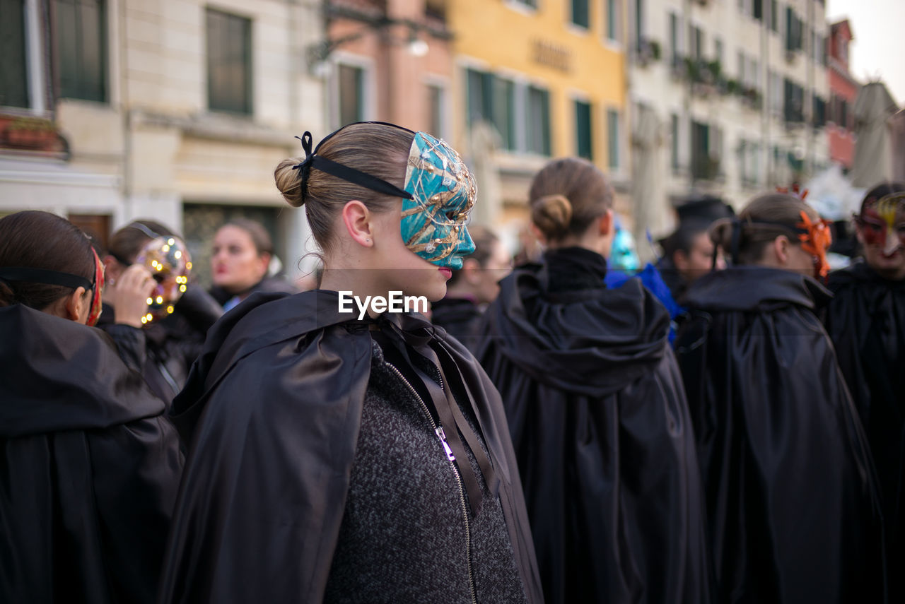 Women wearing mask against buildings8