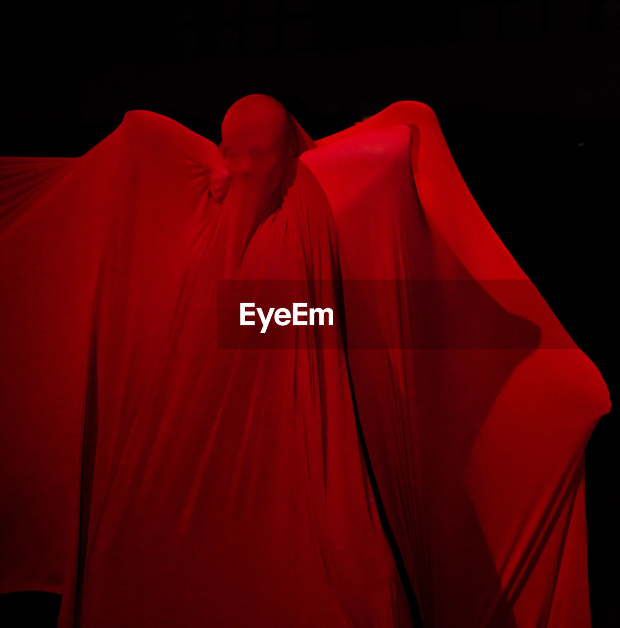 red, studio shot, textile, black background, indoors, no people, night, close-up