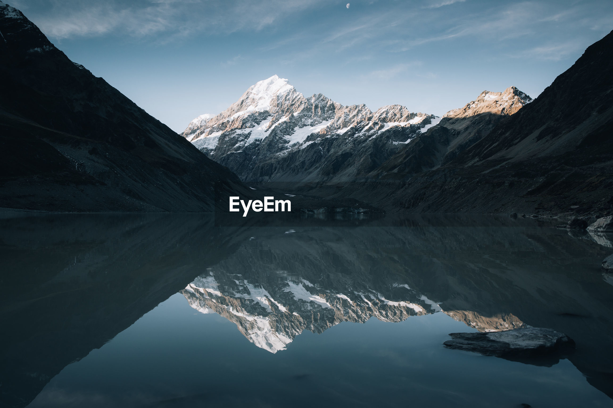 Scenic view of lake against snowcapped mountains