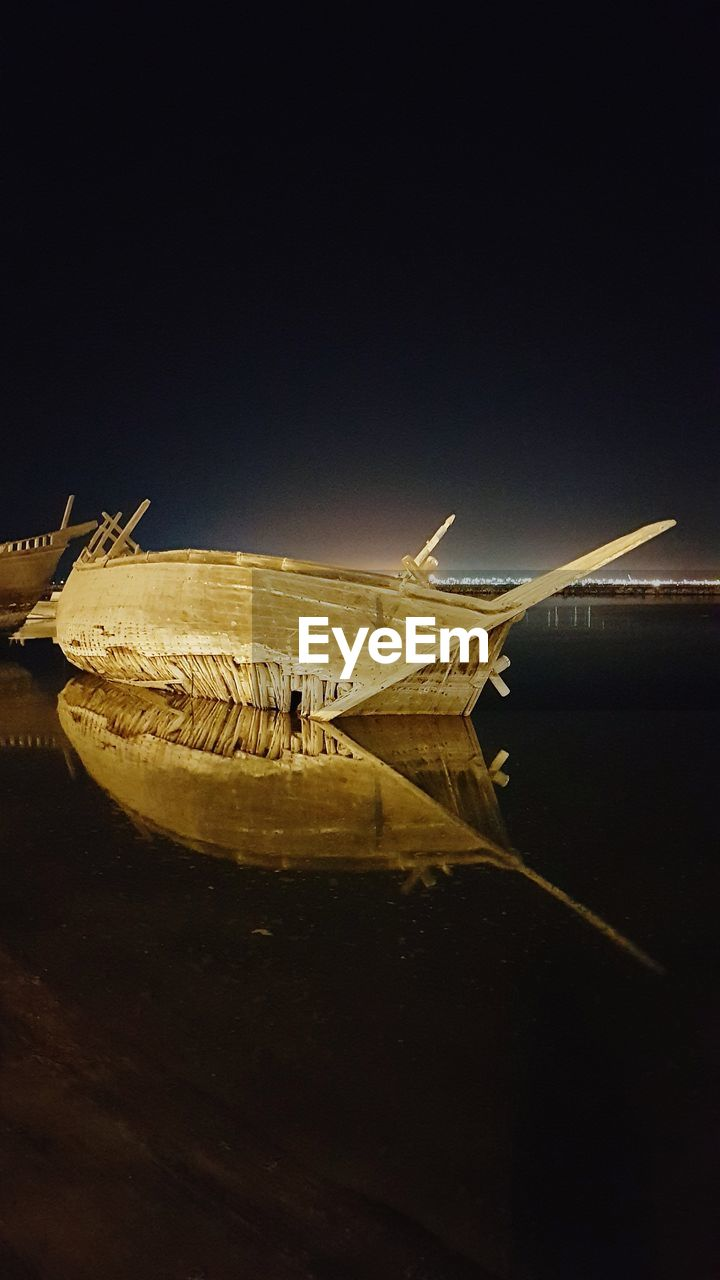 mode of transportation, transportation, night, nautical vessel, water, copy space, no people, illuminated, nature, reflection, sky, sea, clear sky, motion, air vehicle, airplane, outdoors, moored, travel