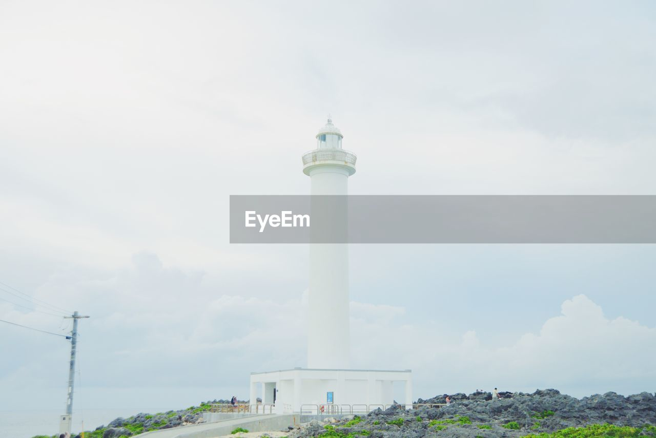 Low angle view of lighthouse against cloudy sky