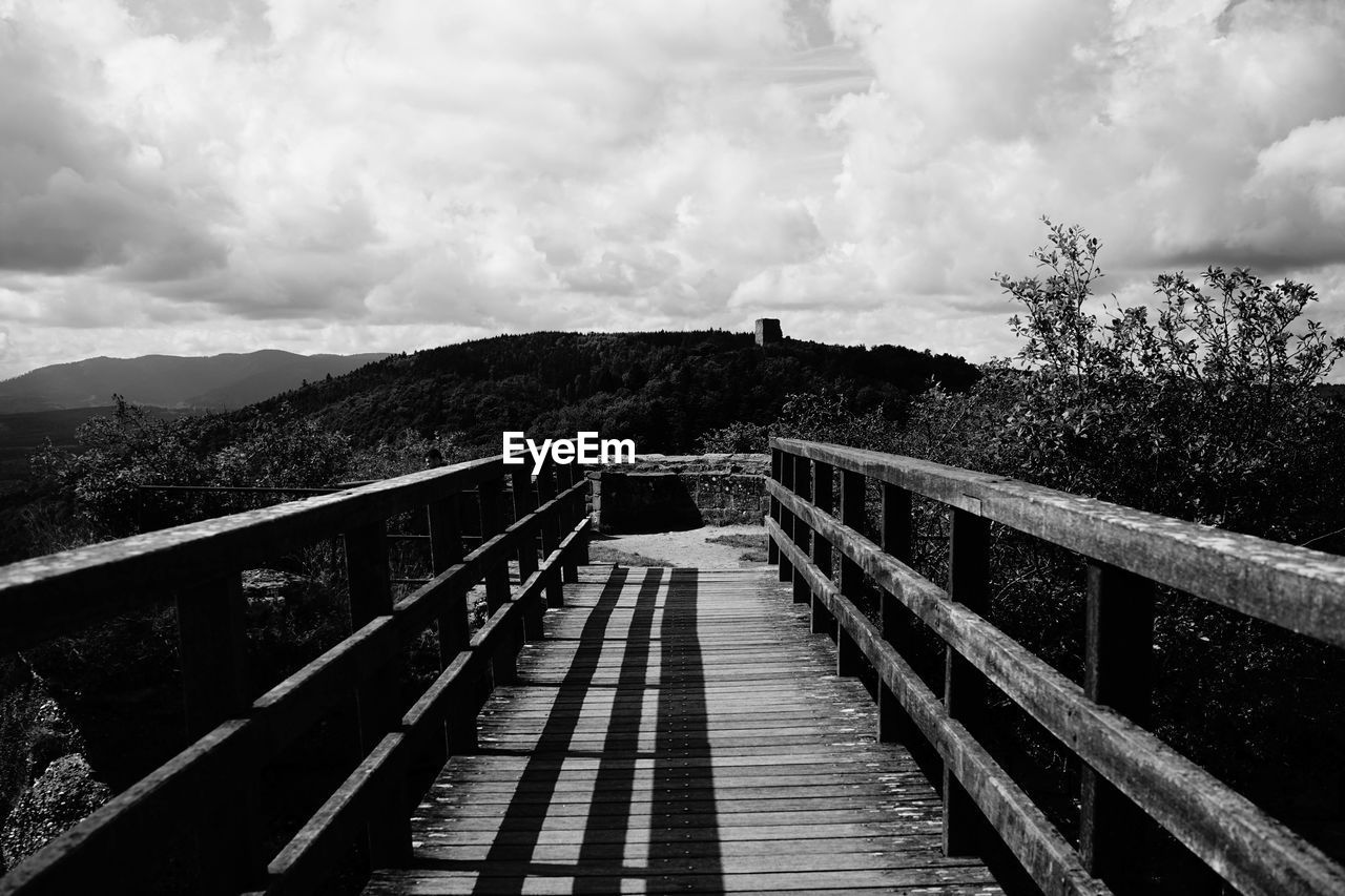 sky, cloud - sky, direction, the way forward, built structure, railing, architecture, nature, tree, mountain, bridge, plant, no people, connection, day, footbridge, outdoors, beauty in nature, footpath, tranquil scene, diminishing perspective, long