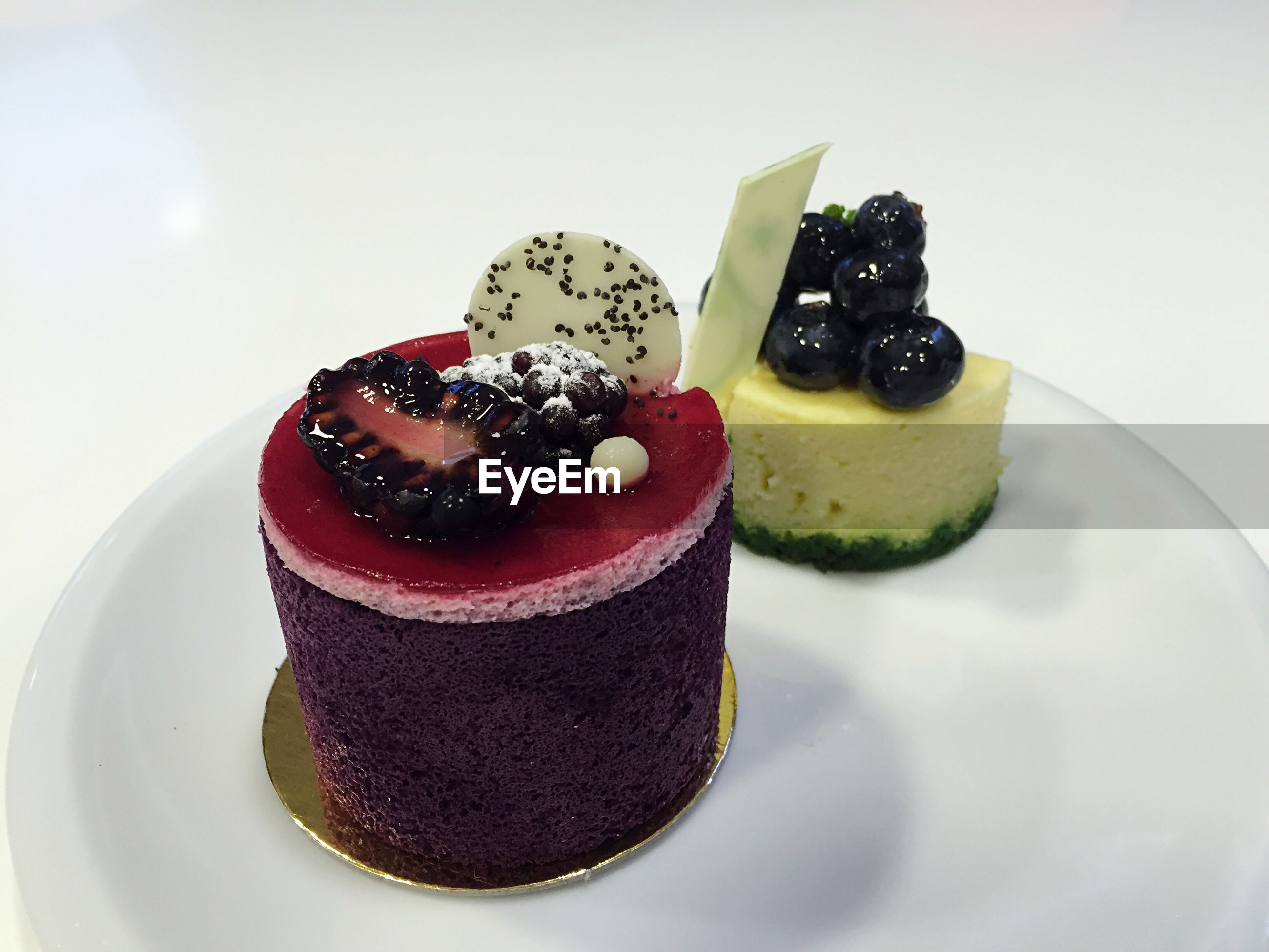 Close-up of cakes in plate against white background