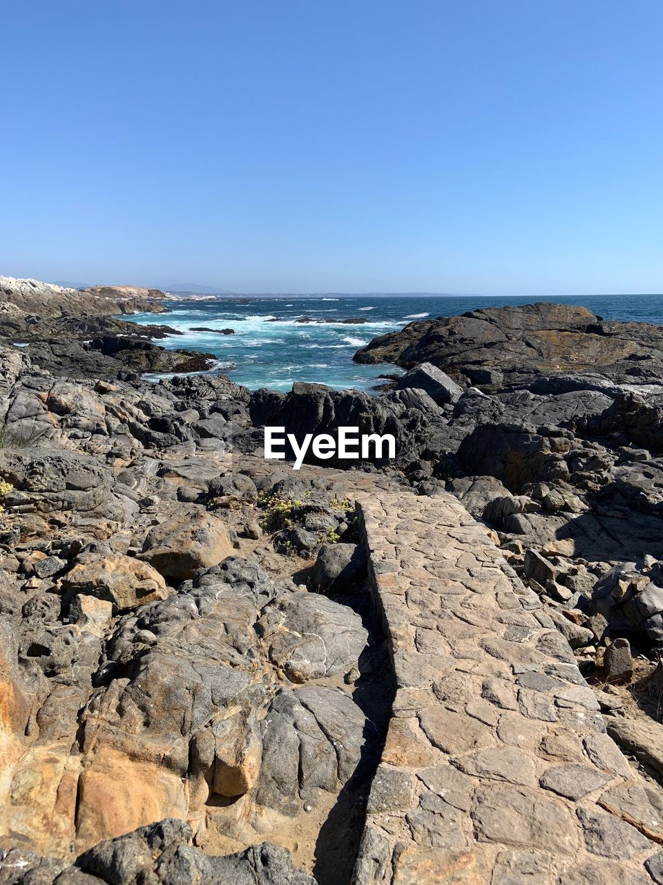 sky, sea, rock, water, solid, rock - object, clear sky, beauty in nature, nature, scenics - nature, horizon, copy space, land, horizon over water, day, beach, rock formation, tranquility, tranquil scene, no people, outdoors, rocky coastline, eroded