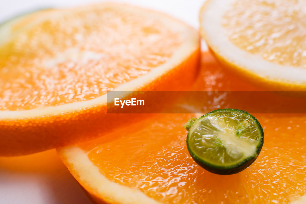 food and drink, food, fruit, citrus fruit, healthy eating, freshness, slice, wellbeing, close-up, orange color, cross section, indoors, orange, still life, no people, orange - fruit, refreshment, juicy, focus on foreground, table, glass, ripe, antioxidant, vitamin c