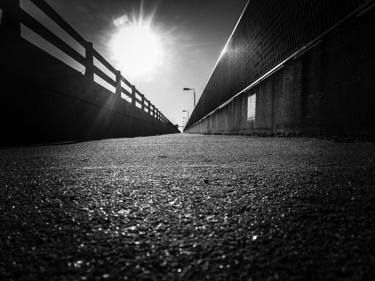 surface level, architecture, built structure, transportation, bridge - man made structure, no people, day, outdoors, the way forward, sunlight, sky