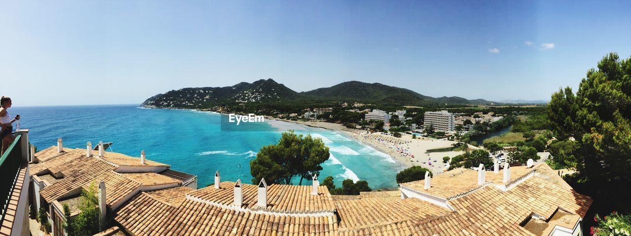 water, sky, sea, scenics - nature, tree, nature, architecture, plant, beauty in nature, day, tranquil scene, tranquility, built structure, panoramic, horizon over water, mountain, high angle view, blue, horizon, no people, outdoors, swimming pool, bay