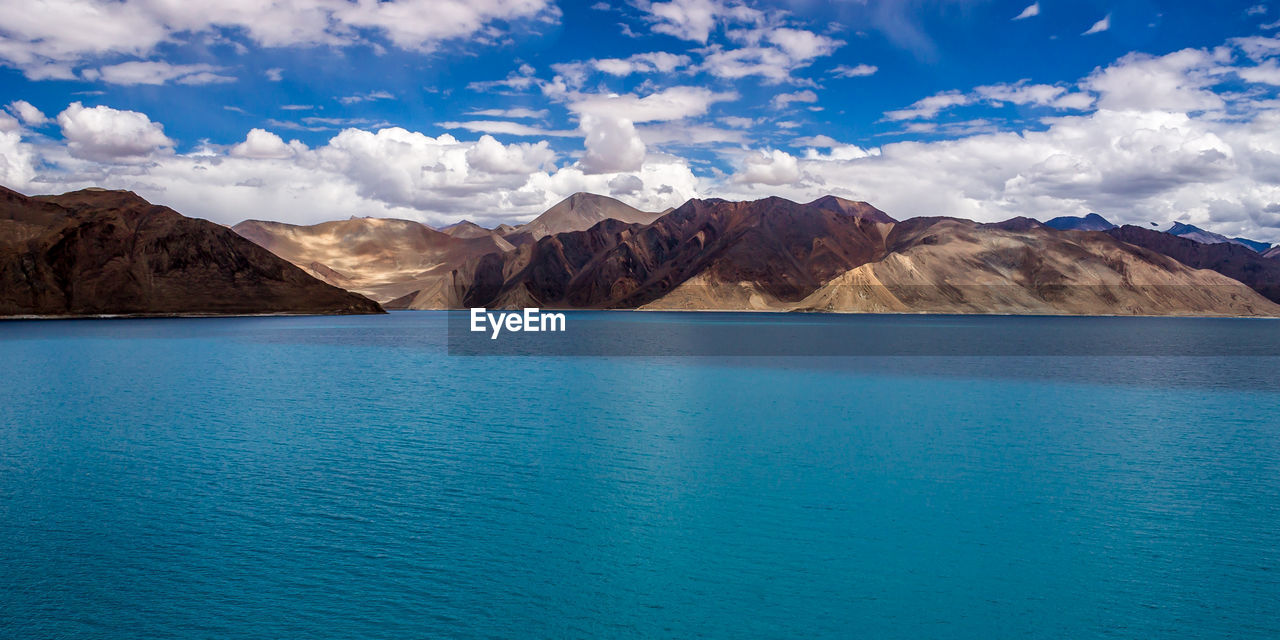 Scenic View Of Lake And Mountain Against Sky