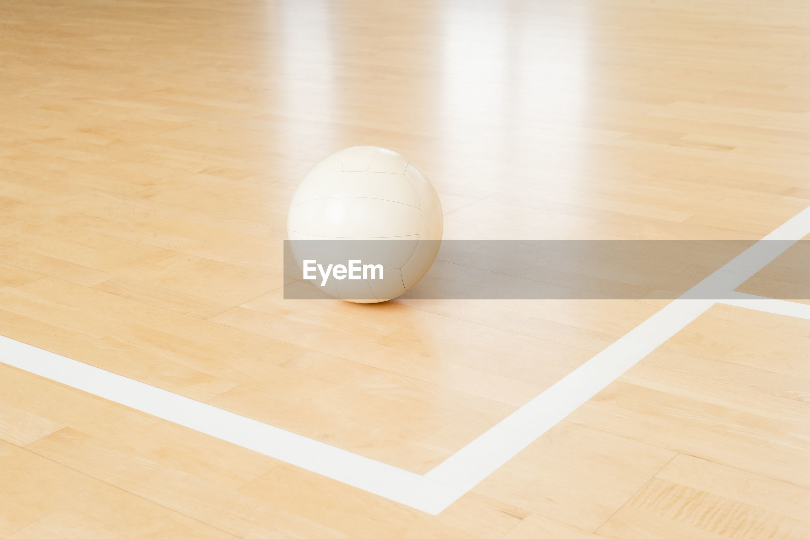 Close-up of on volleyball on court